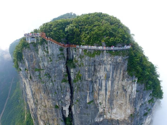The skywalk wraps around Tianmen Mountain in Zhangjiajie National Forest Park. Picture: Shao Ying/Imagine China