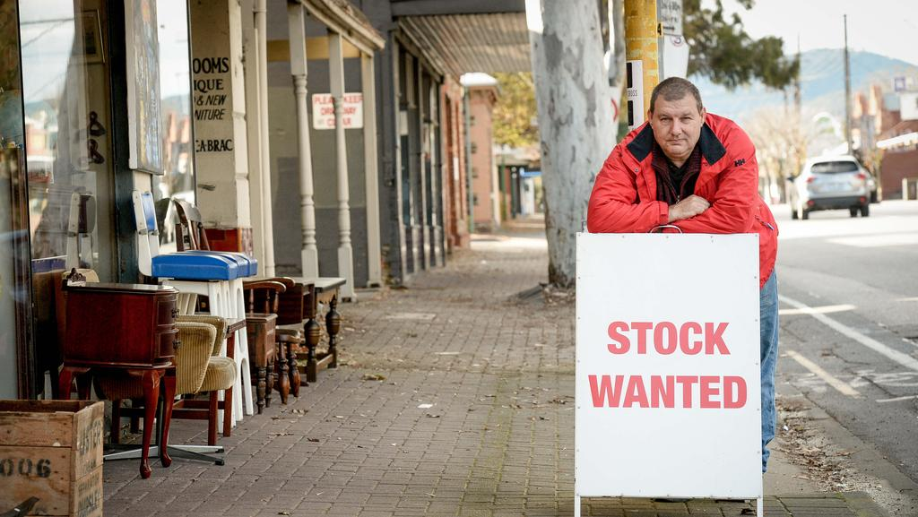 Kensington Antiques owner Patrick Dolan is frustrated that his local council has banned stock tables and signs outside stores. Picture: AAP/RoyVanDerVegt