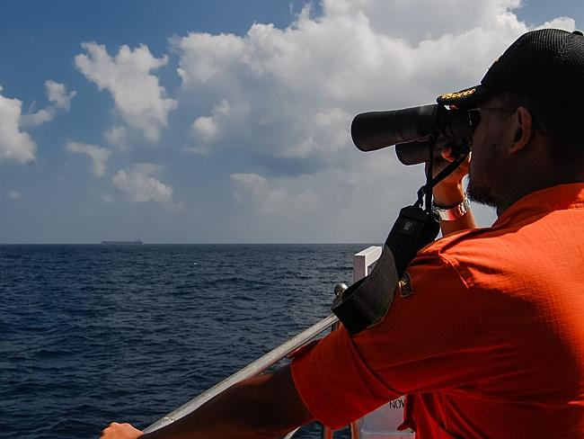 An Indonesian National Search and Rescue Agency personnel scans the seas in the Malacca Strait off Aceh province. Picture: AFP