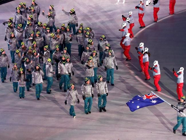 Flag bearer Scotty James of Australia and teammates enter the stadium during the Opening Ceremony of the PyeongChang 2018 Winter Olympic Games. Picture: Getty