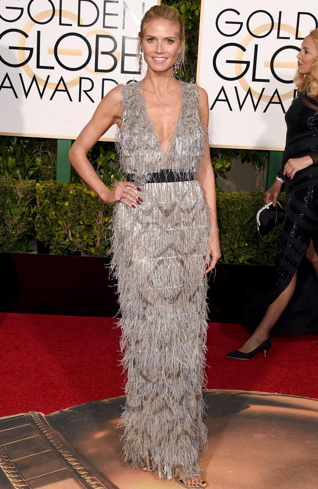 Feathered ... Heidi Klum attends the 73rd Annual Golden Globe Awards. Picture: Getty