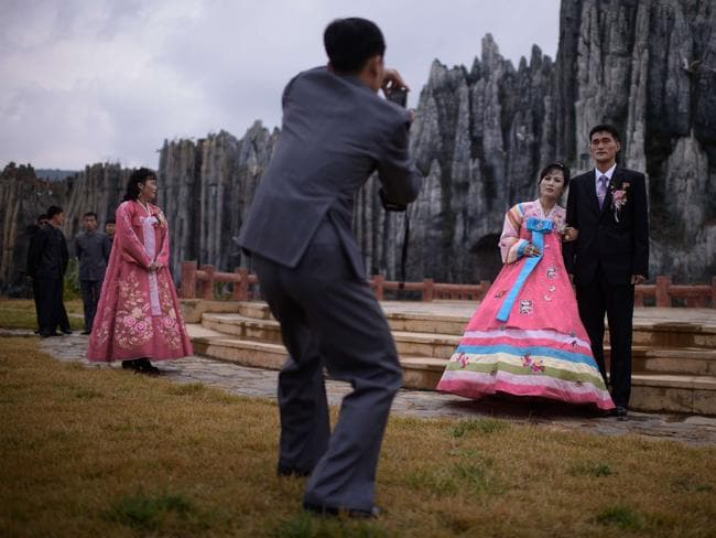 A photo session at Pyongyang Folk Park. Where are the smiles?