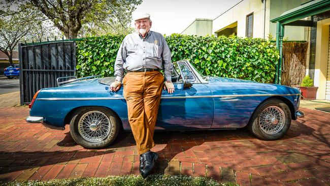 John Trainer with his 1970 MGB at his Unley home. Picture: AAP/Roy VanDerVegt