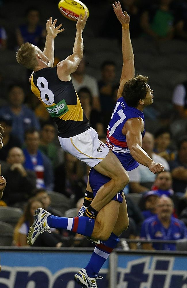 Jack Riewoldt flies high on Will Minson but failed to complete the mark. Picture: Michael Klein.