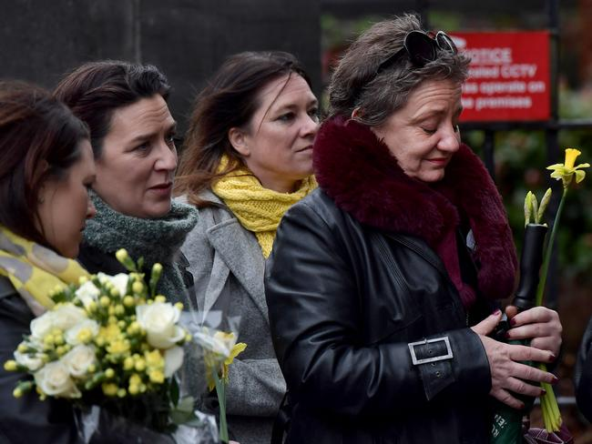 Mourners and members of the public pay their respects to the late singer Dolores o'Riordan as she lays in repose inside St. Joseph's church in Limerick, Ireland. Picture: Getty