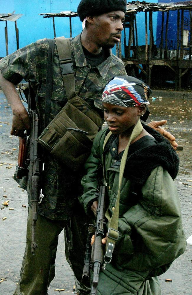 Joining the war ... a rebel Liberian gunman and child soldier in Monrovia, Liberia, in 2003.