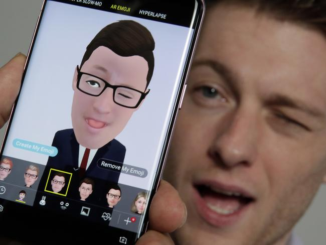 Samsung's Aaron Baker demonstrates the AR Emoji feature on a Samsung Galaxy S9 Plus mobile phone during a product preview in New York. Picture: Richard Drew