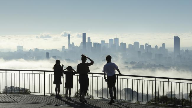 Fog clouds the view of Brisbane City from Mt Coot-tha. Picture: Mark Cranitch