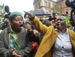 African National Congress supporters protest outside Pretoria's North Gauteng High Court on March 3, 2014, on the opening day of Oscar Pistorius' murder trial. Picture: AFP PHOTO / ALEXANDER JOE