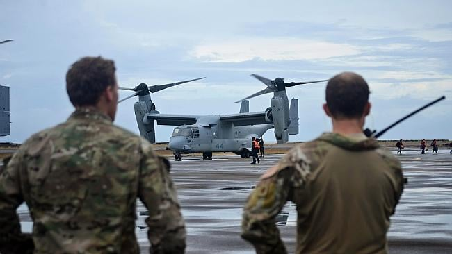 Aid workers disembark a V-22 Osprey as they arrive to assist survivors in an area devastated by Typhoon Haiyan in Leyte, Philipp