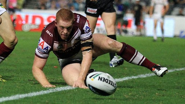 Tom Symonds scores the opening try for Manly against the Wests Tigers. Picture: Mark Evans