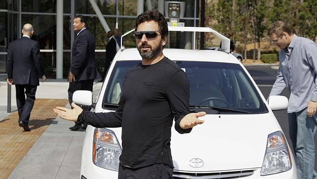 Futurist... Google co-founder Sergey Brin gestures after riding in the driverless car. Picture: Eric Risberg