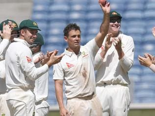 Australia's Steve O'Keefe is congratulated by teammates as he shows the ball after taking 5 wickets in the 2nd innings on the third day of the first cricket Test match between India and Australia at The Maharashtra Cricket Association Stadium in Pune on February 25, 2017. ----IMAGE RESTRICTED TO EDITORIAL USE - STRICTLY NO COMMERCIAL USE----- / GETTYOUT / AFP PHOTO / INDRANIL MUKHERJEE / ----IMAGE RESTRICTED TO EDITORIAL USE - STRICTLY NO COMMERCIAL USE----- / GETTYOUT