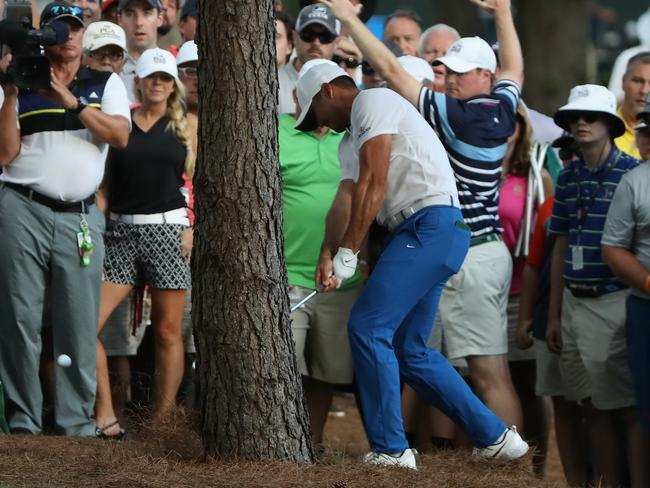 Jason Day runs into some tree troubles on the 18th.