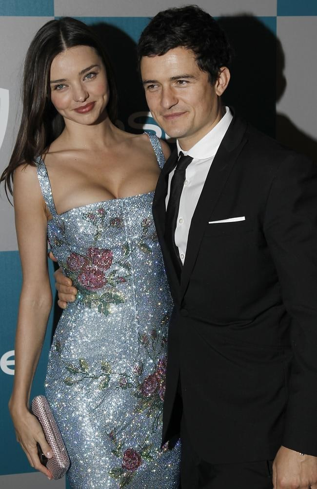 Miranda Kerr, left, and Orlando Bloom in 2012 in happier times. Picture: AP