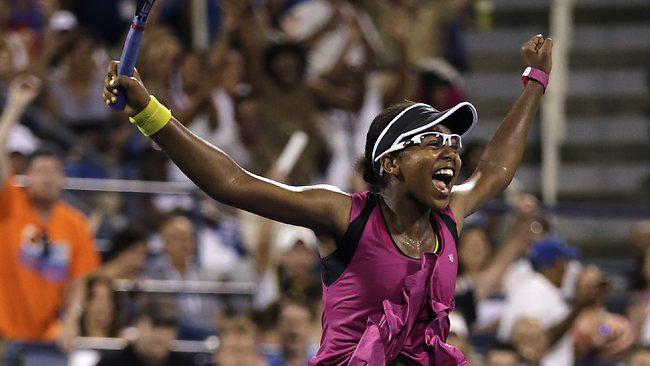 Victoria Duval raises her arms after her stunning upset victory over 2011 US Open champion Samantha Stosur.