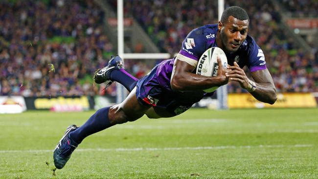 Suliasi Vunivalu dives over for his second try against the Warriors. Picture: Colleen Petch.