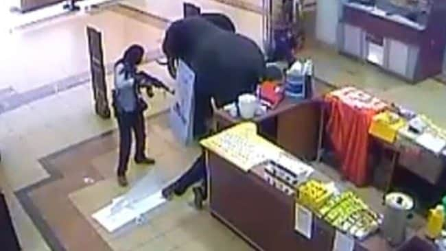 CCTV footage from the Westgate Mall in Kenya shows a gunman shooting one shopper who lays on the ground. Picture: CNN