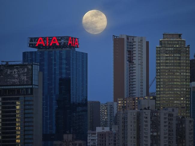 Over high-rise buildings in Hong Kong. AP Photo/Vincent Yu