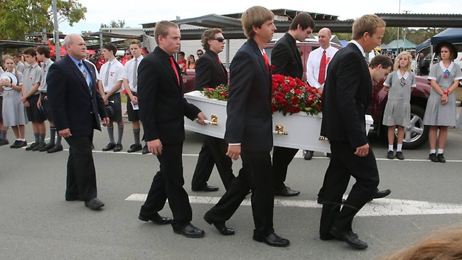Daniel Morcombe's casket is carried from St Catherine of Siena Catholic church on the Sunshine Coast. Picture: Glenn Barnes