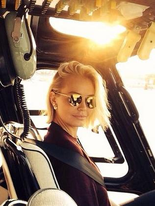 Sunscreen free... Lara Bingle looking her normal self in a chopper, in a pic posted around the same time as the sunscreen shot. Picture: Instagram