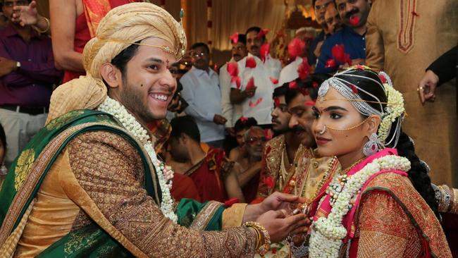 Daughter Of Gali Janardhan Reddy Bramhani R Sits With Her Groom Rajeev During Their Wedding Picture AAPSourceAFP