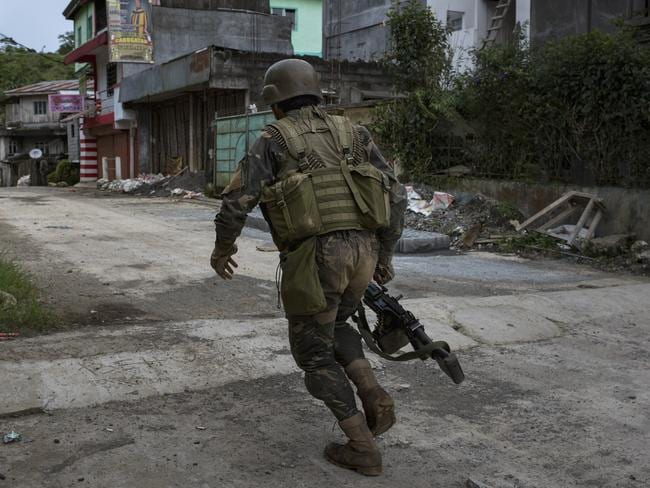 Soldiers run for cover in Marawi city during gunbattles between ISIS-linked militants and Filipino troops in May. Picture: Jes Aznar/Getty Images
