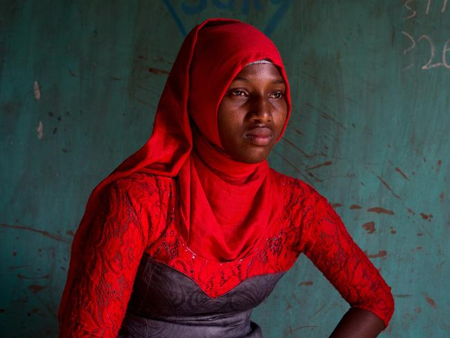 "Russia's Asha Miles has been honoured for her series Scars, which focuses on the stories of 12 Gambian women who survived female genital mutilation as children. Pictured here is Amie Sowie, 19. ""I do not remember anything about the ceremony of circumcision, I was not even a year old. About what it did to me, I only found out when I was older. I remember that I was so upset and offended by my mother, when I found out, that I did not talk to her for a very long time. I already knew by then that it was bad. We were told about this in school. I'm glad that today the operation is banned. I myself could not do without the consequences — my stomach often hurts, and the doctor says that maybe it's because of circumcision. But I was lucky compared to my younger sister — she was constantly experiencing pain during urination and did not go to school for months."" Source: Supplied"