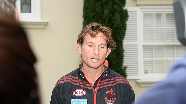April 15, 2013: Essendon coach James Hird talks to media outside his Toorak home.