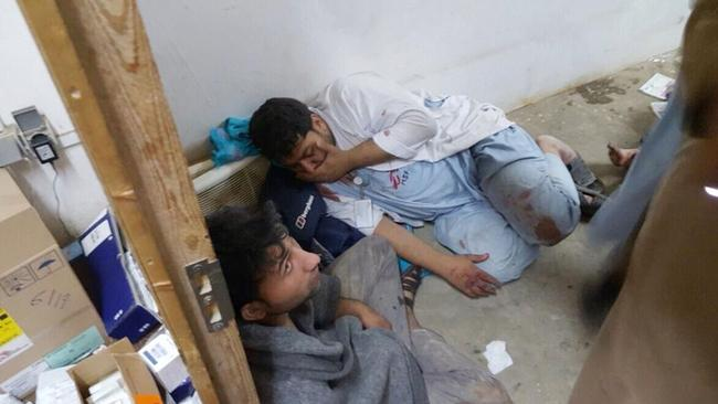 Injured Doctors Without Borders staff are seen after explosions near their hospital in the northern Afghan city of Kunduz, on Saturday, Oct. 3, 2015.
