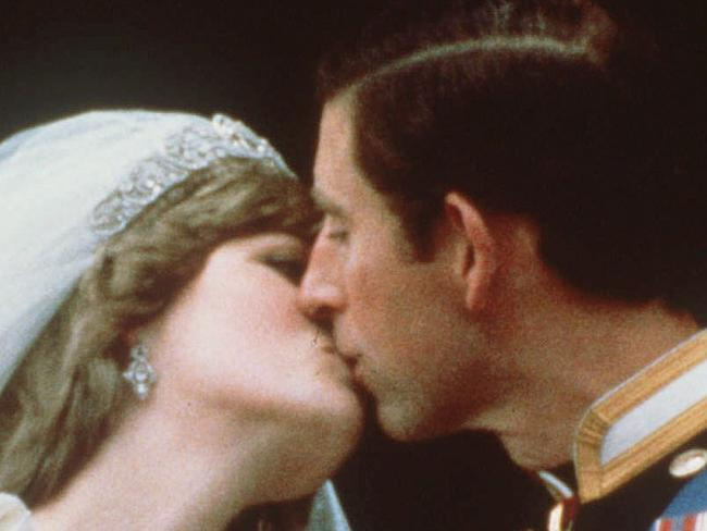 Britain's Prince Charles kisses his bride, the former Diana Spencer, in this July 29, 1981 file photo, on the balcony of Buckingham Palace in London after their wedding. (AP Photo)