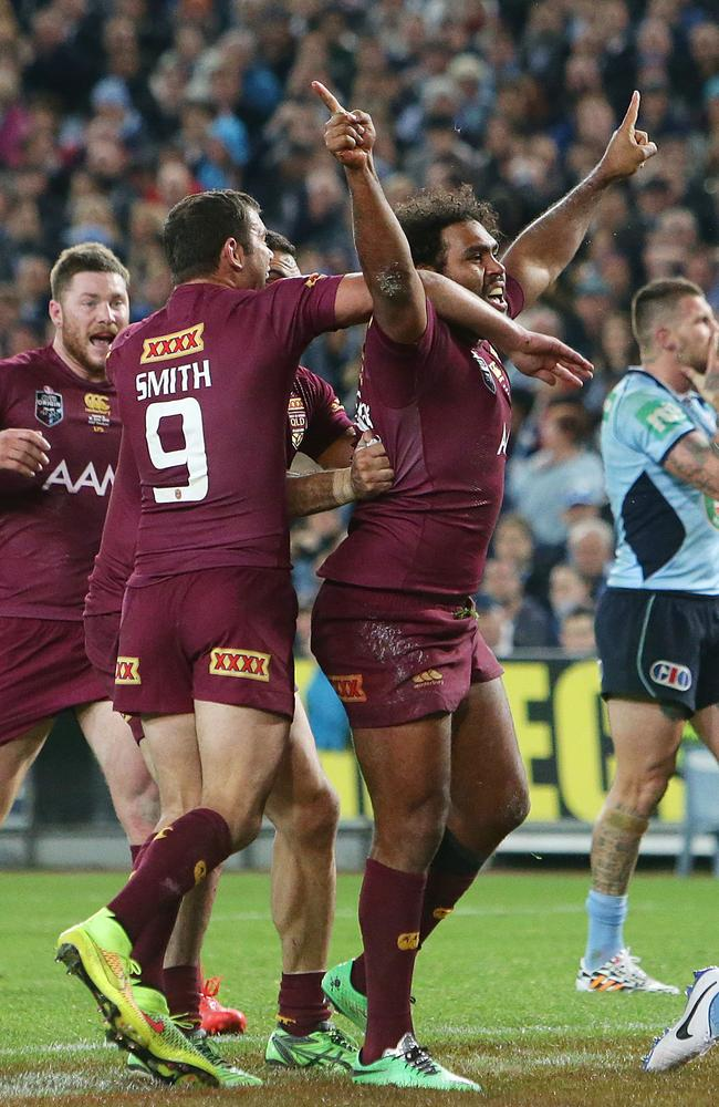 The Maroons celebrate what they thought was a breakthrough try in Origin II.
