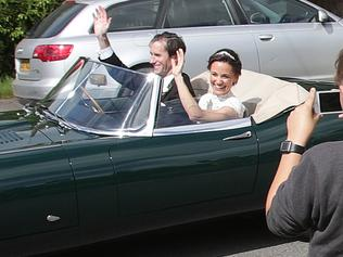 Pippa Middleton and James Matthews wave as they drive a Jaguar E-Type after their wedding, dubbed the society wedding of the year, at St Mark's church in Englefield, Berkshire.. Picture date: Saturday May 20, 2017. See PA story ROYAL Pippa. Photo credit should read: Yui Mok/PA Wire