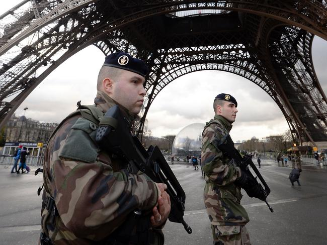 French soldiers patroling in front of the Eiffel Tower in Paris. Picture: Bertrand Guay/AFP