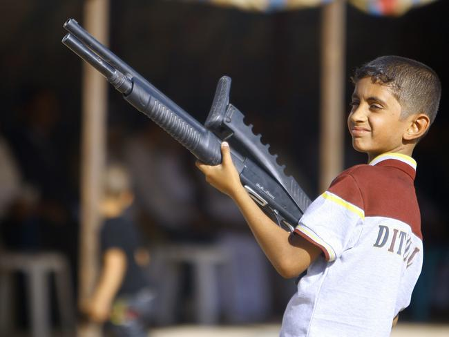 War child ... An Iraqi boy holds a weapon as he takes part in a gathering by Shiite tribesman to show their willingness to join Iraqi security forces in the fight against Jihadist militants.