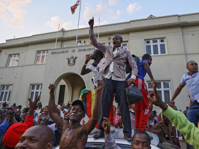 Zimbabweans celebrate outside the parliament building immediately after hearing the news that President Robert Mugabe had resigned. Picture: AP