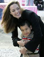 <p>Actor Angelina Jolie talks to her son Maddox at a news conference in New Orleans' Lower 9th Ward. Jolie was attending the news conference where actor Brad Pitt announced his latest project to build affordable, environmentally friendly homes in the area d</p>