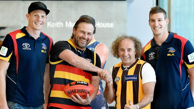 Crows players Sam Jacobs and Josh Jenkins flank retired greats Tony Modra and John Platten. Picture: Roy vanDerVegt