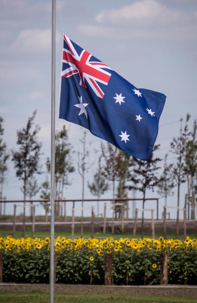 An Australian flag flies at half-mast at the memorial. Picture: Franck Bessiere