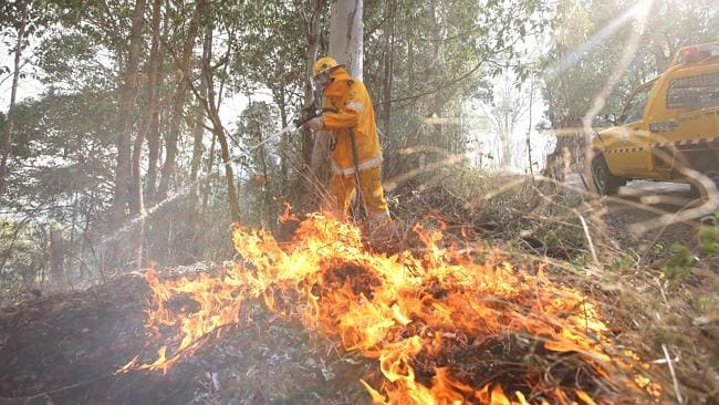 Bushfire fighters from Rocksberg Moorina rural fire brigade putting out fires at Rocksberg. Picture: Jamie Hanson