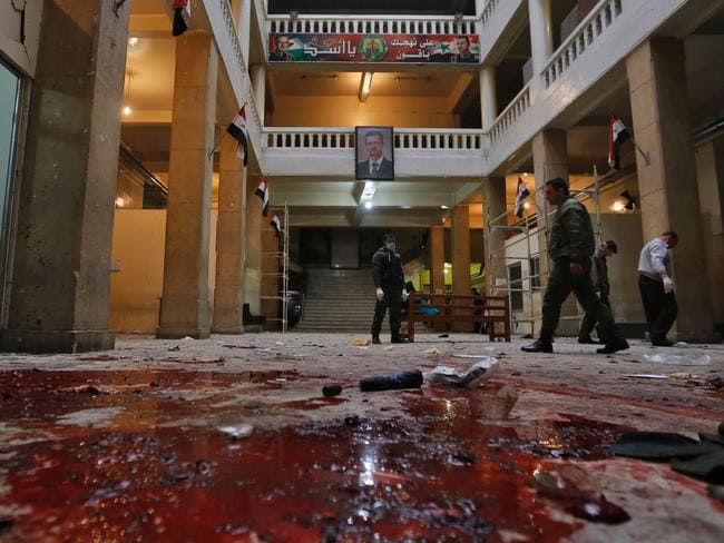 A portrait of Syrian President Bashar Assad hangs in the courthouse where a suicide bomber detonated an explosives vest. Picture: AFP/Louai Beshara
