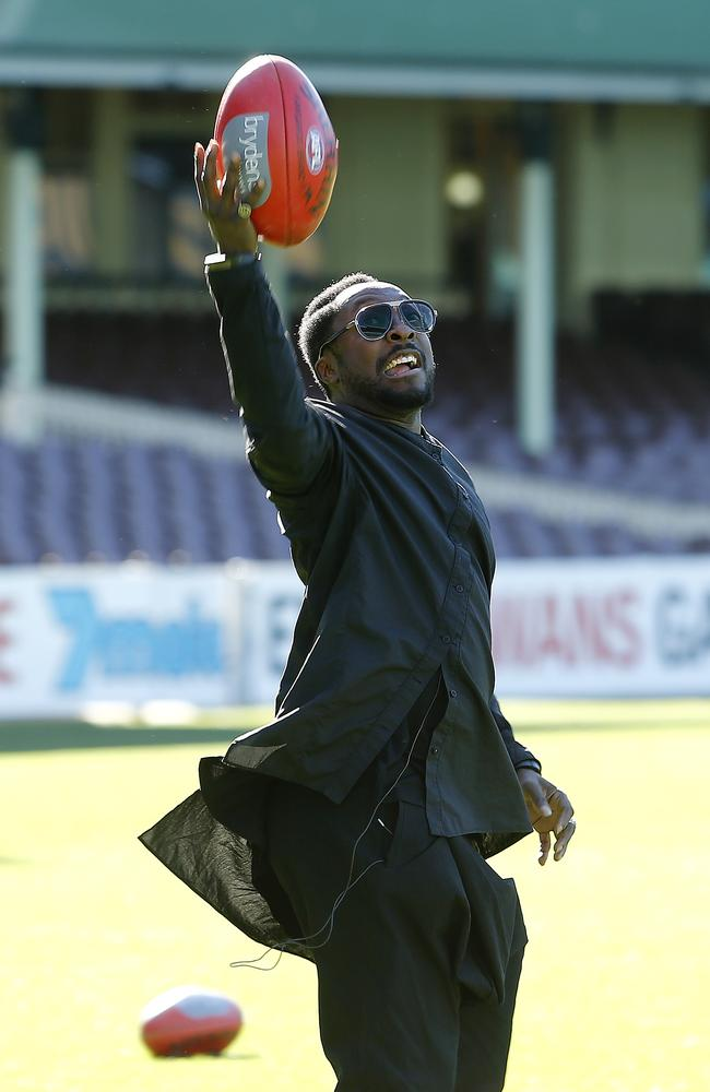 Marked ... The Voice coach will.i.am kicks it on the Sydney Cricket Ground. Picture: Tim Hunter