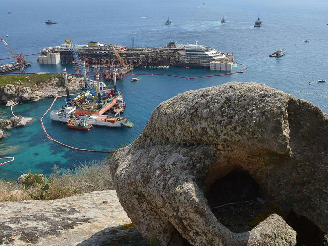 Massive ... the wreck of the  <i>Costa Concordia </i>off the coast. Picture: AFP