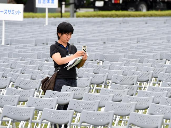 A staff member of Hiroshima City checks the venue before the memorial. Pic: AFP/ Toru Yamanaka