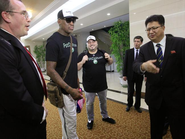Former NBA basketball star Dennis Rodman (centre) is greeted by North Korea's Sports Ministry Vice Minister Son Kwang-ho (right) at Sunan International Airport in Pyongyang. Picture: AP Photo/Kim Kwang Hyon