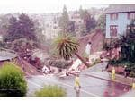 <p>City officials survey 60 foot deep sinkhole which swallowed 2 homes in San Francisco's exclusive Sea Cliff district & forced evacuation of 9 other homes 11/12/95, hole measured approximately 200 feet by 150 feet & fire department said was probably caused by broken sewer pipe, Sea Cliff is perched on wind swept, rocky cliffs near Presidio. United Staes of America (USA) / Accident</p>