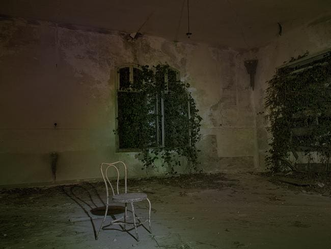 Chilling ... rooms in the mental asylum at night on Poveglia Island. Picture: Ella Pellegrini