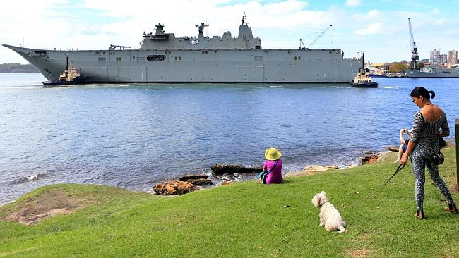 Spectators take in the humungous vista that is Australia's biggest warship 'Nuship Canberra'. Picture: Mark Evans