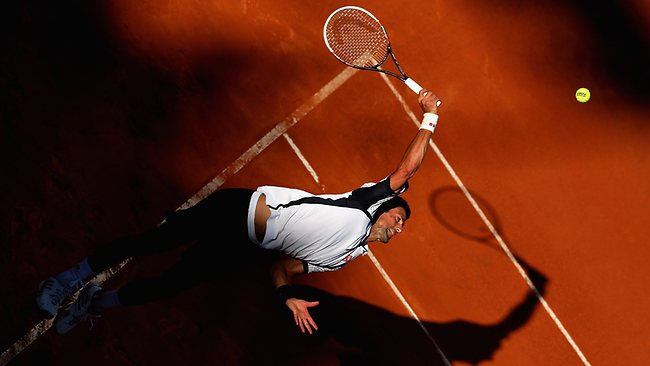 Novak Djokovic serves against Albert Montanes of Spain in their second round match at the Italian Open. Picture: Clive Brunskill