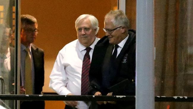 Busted ... Clive Palmer and Malcolm Turnbull leave the Wild Duck Chinese restaurant in Canberra on Wednesday.